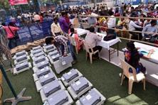 Officials gear up for the election preparation, while teachers deployed on election duty checks the working AVM machines at a training camp in Mumbai on Monday. Photo: PTI