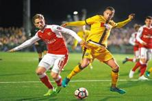Sutton United's Craig Eastmond (right) and Arsenal's Nacho Monreal during an FA Cup match at the Gander Green Lane stadium on Monday. Photo: Matt Dunham/AP
