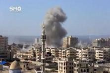A still image taken from a video uploaded to a social media website, on 25 February, 2017, purports to show air strikes in the rebel-held al-Waer area of Homs, Syria. Photo: Reuters