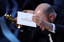 'La la Land' producer Jordan Horowitz holds up the card for the Best Picture winner 'Moonlight' at the 89th Academy Awards on Sunday night. Photo: Reuters