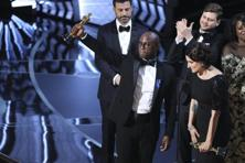 'Moonlight' writer and director Barry Jenkins holds up the Best Picture Oscar. Photo: Reuters