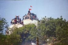 Karsevaks atop Babri Masjid before it was demolished on 6 December, 1992. Photo: HT