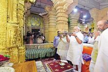 Prime Minister Narendra Modi and BJP president Amit Shah offer prayers at Somnath Temple in Gujarat on Wednesday. Photo: PTI