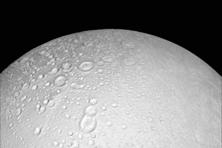 Saturn's icy moon Enceladus has an underground ocean of liquid water that may be only a few kilometres beneath the surface according to NASA scientists who found that the south polar region of the moon is warmer than expected. In above picture, the north pole of Saturn's icy moon Enceladus as seen in an image from NASA's Cassini spacecraft taken on 14 October 2015. Photo: Reuters