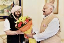 Captain Amarinder Singh meets Punjab governor V.P. Singh Badnore at Raj Bhawan in Chandigarh on Sunday. Photo: PTI