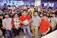 UrbanClap co-founders Abhiraj Bhal, Varun Khaitan and Raghav Chandra with the company's employees. Photos: Pradeep Gaur/Mint