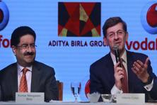 Kumar Mangalam Birla (left), chairman of Aditya Birla Group of which Idea Cellular is a part, and Vodafone's Vittorio Colao announced the Idea-Vodafone merger on Monday. Photo: AP