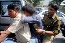 An Anti-Romeo squad of the UP police transport a detained youth in Lucknow on Wednesday. Photo: PTI