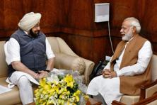 Punjab Chief Minister Amarinder Singh with Prime Minister Narendra Modi at Parliament House in New Delhi on Wednesday. Photo: PTI