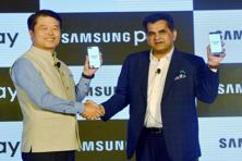 NITI Aayog CEO Amitabh Kant and H.C. Hong, president cum CEO, Samsung Southwest Asia launch Samsung Pay app in Gurugram on Wednesday. Photo: PTI
