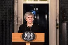 Britain's Prime Minister Theresa May makes a statement at Downing street in London, on 22 March following the attack in Westminster. Photo: Reuters