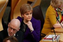 Scotland's first minister Nicola Sturgeon and deputy first minister John Swinney listen to the referendum debate in Edinburgh, Scotland, on 22 March. Photo: Reuters
