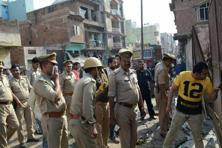 Policemen raid at a slaughterhouse in Moradabad. Photo: PTI