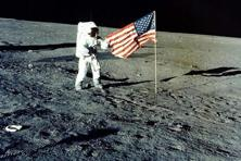 "Charles ""Pete"" Conrad Jr. stands with the US flag on the lunar surface during the Apollo 12 mission, in 1969. Photo: Reuters"