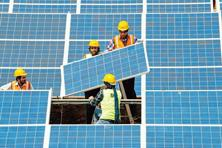 Module prices, which make up for about 60% of a solar project's total costs, have fallen by 26% in 2016 alone and are expected to fall another 20% this year, giving possibility to tariffs falling further. Photo: AFP