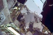 A NASA TV grab image shows US astronaut Shane Kimbrough (top) and French astronaut Thomas Pesquet as they remove a battery outside the Space Staion. Photo: AFP /Nasa TV