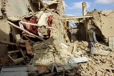 An Afghan man inspects a house destroyed during a US air strike called in to protect Afghan and US forces during a raid on suspected Taliban militants, in Kunduz, Afghanistan in November. File photo: Reuters