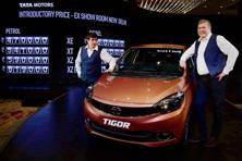 Tata Motors MD Guenter Butschek (left) at the Tata Tigor launch in Mumbai on Wednesday. The new compact sedan, positioned as a 'styleback' is based on the Tiago platform. Photo: PTI
