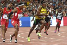 A file photo of Usain Bolt during a relay race. Photo: AFP