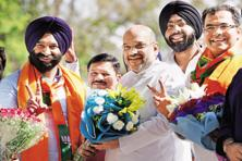 BJP president Amit Shah with BJP-SAD joint candidate Manjinder Singh Sirsa who won the Rajouri Garden seat in New Delhi on Thursday. Photo: PTI
