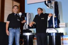 "TAL Manufacturing Solutions chairman R.S. Thakur (right) and TAL chief operating officer Amit Bhingurde. BRABO—short for ""Bravo Robot""—is priced at Rs5-7 lakh and can even be bought on EMIs. Photo:"