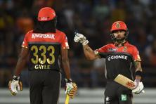 Chris Gayle slammed a 38-ball 77-run innings, while skipper Virat Kohli produced a superb 50-ball 64 to guide RCB to a massive 213-2 after Gujarat Lions skipper Suresh Raina won the toss and elected to field. RCB restricted the Lions to 192-7 to snap their three-game losing streak. Photo: AFP