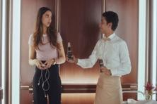 Coca Cola ad opens with Deepika Padukone escaping media frenzy outside a hotel and taking an elevator which breaks down abruptly.