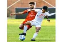 Aizawl FC's Lalramchullova (in white) in an I-League match against Churchill Brothers in Goa. Photo: PTI