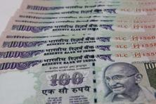 The rupee opened at 64.13 a dollar and touched a high and a low of 64.12 and 64.38, respectively. Photo: Hindustan Times