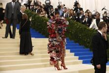 Singer Rihanna in a custom Comme des Garçons floral dress with cutouts and oversized ruffles. Reuters