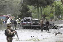Security forces inspect at the site of a suicide attack in Kabul, Afghanistan, on Wednesday. Photo: AP