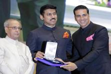 Bollywood actor Akshay Kumar (right) receives the  Best Actor award for his patriotic turn in crime thriller 'Rustom' from  junior minister for information and broadcasting Rajyavardhan Singh Rathore (centre) and President Pranab Mukherjee in New Delhi. AP.
