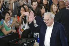 Berkshire Hathaway CEO Warren Buffett waves to shareholders at the company-owned Borsheims jewellery store in Omaha on Sunday. Photo: AP