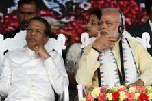 Narendra Modi and Sri Lankan President Maithripala Sirisena look on during a public rally in the tea-growing town of Norwood, some 80 km east of Colombo on 12 May. Photo: AFP