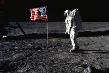 This Nasa handout photo taken on 20 July 1969 shows Astronaut Edwin E. Aldrin, Jr., lunar module pilot of the first lunar landing mission, posing beside the deployed US flag during Apollo 11 Extravehicular Activity on the lunar surface area called the Sea of Tranquility. Photo: AFP