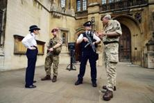 Hundreds of soldiers were sent to secure key sites across the country, including Buckingham Palace and the British Parliament at Westminster. Photo: AFP