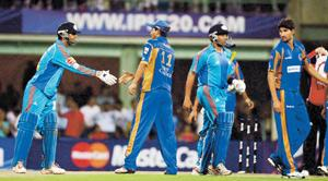 Game plan: Mumbai Indians and Rajasthan Royals team members in a file photo. While losing the telecast rights to a rival will hurt MSMPL, BCCI won't be able to sign a fresh contract with a new broadca