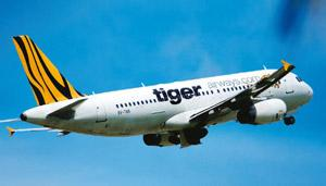Decision time: A Tiger Airways airplane takes off from Changi Airport in Singapore on Sunday. Munshi Ahmed / Bloomberg