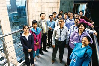 Out of the rut: TCS Innovation Lab's Delhi team. Principal scientist Hiranmay Ghosh (centre) and Gautam Shroff (left, wearing a tie), who heads the lab.Madhu Kapparath/Mint