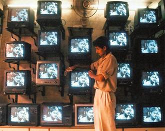 Shining star: Satellite television in the 1990s became the show window of economic reforms .Photo AFP