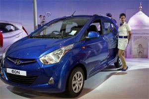 A Model Poses With Eon Car At The 11th Auto Expo In New Delhi On Friday