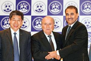 At the helm: (from left) Asian Football Confederation's Zhang Jilong, Sepp Blatter and Union minister Praful Patel in New Delhi. By B Mathur/Reuters