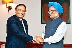 Diplomatic overtures: Pakistan President Asif Ali Zardari (left) shakes hands with India's Prime Minister Manmohan Singh in New Delhi on Sunday. Zardari was on his first visit to India as head of stat