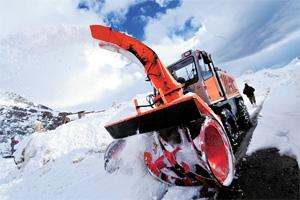The Rolba 1500, a snow cutter, tears through a mound of snow on the way to Marhi. Ramesh Pathania/Mint