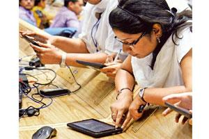 Market potential: Students checking out Aakash tablets. Widespread adoption of tablets in the country's schools and colleges could be a game changer for the devices. Photo: Hindustan Times