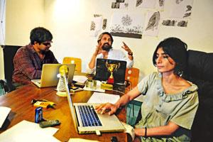 Building blocks: (from left) Shuddhabrata Sengupta, Jeebesh Bagchi and Monica Narula finalizing entries. Photo: Priyanka Parashar/Mint