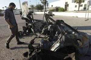 A military personnel examines a car, which exploded near a women's police academy, in Tripoli on Sunday. Photo: Reuters