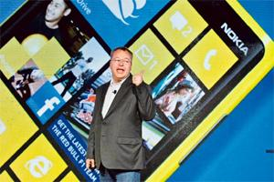 Big bets: Nokia CEO Stephen Elop introduces new Nokia phones with Microsoft's Windows 8 operating system in New York on Wednesday.