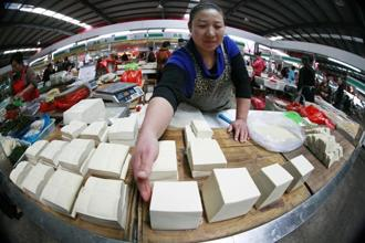 A tofu vendor at her stall in Huaibei, China. China's annual consumer price inflation ticked down to 1.9% in September from 2% in August, leaving room for further policy easing. Reuters