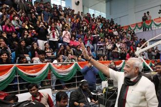 "Gujarat chief minister Narendera Modi waves to students at the annual ""Shri Ram Memorial Oration"" as part of Shri Ram College of Commerce's management festival in New Delhi on Wednesday. Photo: PTI"
